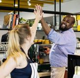 Colleagues give a high five to each other stock photography