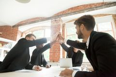 Colleagues giving high five for successful business deal Royalty Free Stock Photography