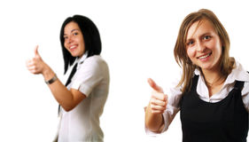 Colleagues giving thumbs up Stock Photo