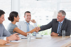 Colleagues greeting each other Stock Photo