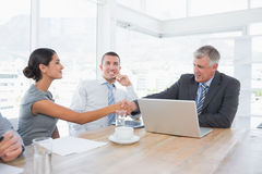 Colleagues greeting each other Stock Images