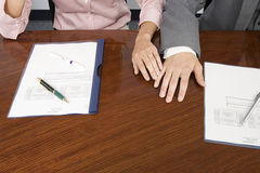 Colleagues hands touching Stock Photo