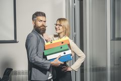 Colleagues hold folders with business documents. Colleagues work together in office, paperwork.  Royalty Free Stock Image