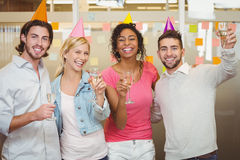 Colleagues holding champagne flute in birthday party Royalty Free Stock Photography