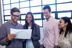 Colleagues holding a document Royalty Free Stock Photography