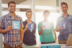 Colleagues holding sign from famous social networks Royalty Free Stock Photography