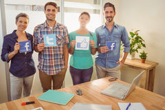 Colleagues holding sign from famous social networks Royalty Free Stock Photo