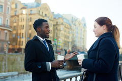 Colleagues Interacting in Streets of City stock image
