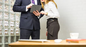 Colleagues interaction. Female office member paying attention to ideas of her coworker. Stock Photos