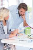 Colleagues of interior design working together on colour charts Royalty Free Stock Image