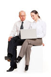 Colleagues with laptop Stock Photography