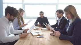 Colleagues look through documents. a business meeting. Group of young businessman at the negotiating table in the office Royalty Free Stock Image