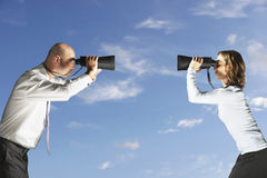 Colleagues Looking At Each Other Through Binoculars Outdoors Stock Images