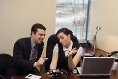 Colleagues Looking at Photos - Horizontal Royalty Free Stock Photo