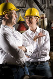 Colleagues in maintenance room Stock Images
