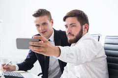 Colleagues making selfie Stock Photos