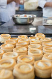 Colleagues making vol-au-vent together Royalty Free Stock Photo