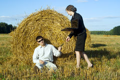 Colleagues in the nature near the haystacks Royalty Free Stock Photography