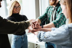 Colleagues in office holding hands of each other royalty free stock photography