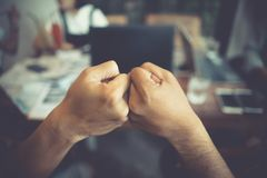 Colleagues partner fist bump finish up office meeting. Mission c Royalty Free Stock Photography