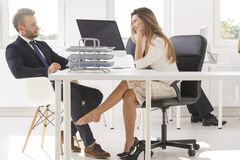 Colleagues playing footsie Royalty Free Stock Images