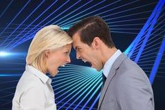 Colleagues quarreling head against head Stock Photo