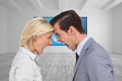 Colleagues quarreling head against head Royalty Free Stock Images