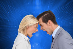 Colleagues quarreling head against head Royalty Free Stock Photography