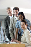 Colleagues with seated businesswoman Stock Photos