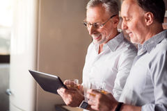 Colleagues sharing funny jokes with each other Royalty Free Stock Photo