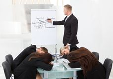 Colleagues sleeping during presentation Royalty Free Stock Photos