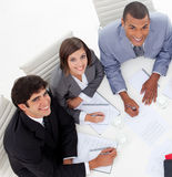 Colleagues smiling at the camera in a meeting Stock Image