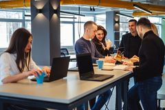 Colleagues smiling while working at the office meeting. Colleagues smiling while working casually at the office meeting stock photo
