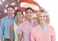 Colleagues standing against american flag in background Royalty Free Stock Photo