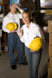 Colleagues in storage area Royalty Free Stock Photography