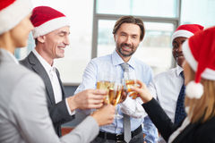 Colleagues toasting Royalty Free Stock Photos