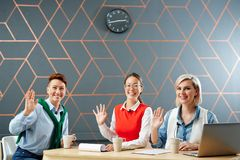 Colleagues from tv studio. Three cheerful women waving hands while greeting their audience in tv studio Stock Photography