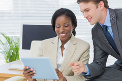 Colleagues using digital tablet in office Royalty Free Stock Image