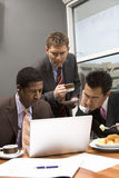 Colleagues Using Laptop During Their Break Royalty Free Stock Photography