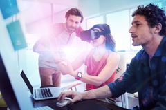 Colleagues using technology. In the office Royalty Free Stock Photography