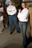 Colleagues in warehouse storage area Stock Photography