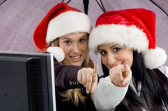 Colleagues wearing christmas hat and pointing royalty free stock photo