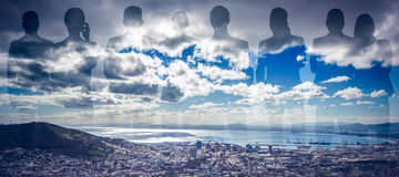 Composite image of colleagues on white background. Colleagues on white background against landscape of city and cloudy sky Stock Image
