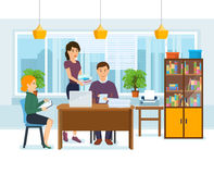 Colleagues work on joint project on background of office interior. Stock Images