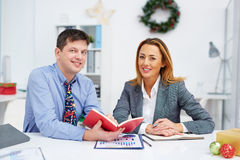 Colleagues at work Stock Images