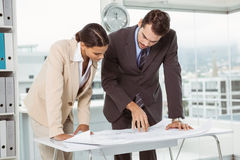 Colleagues working on blueprints Royalty Free Stock Photo