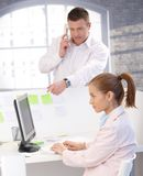 Colleagues working in modular office Stock Photo