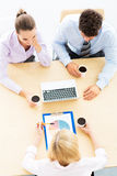 Colleagues working in office, high angle Stock Photos