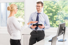 Colleagues working in the office with a tablet Stock Photos
