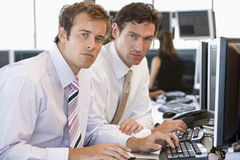 Colleagues Working Together At Computer Royalty Free Stock Images